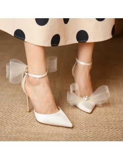 White asymmetric bow pointed high heels