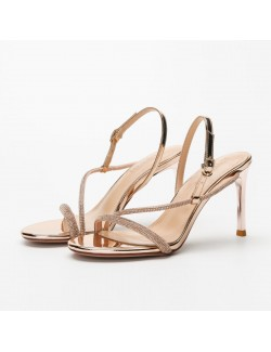 Rose gold strappy heeled sandals