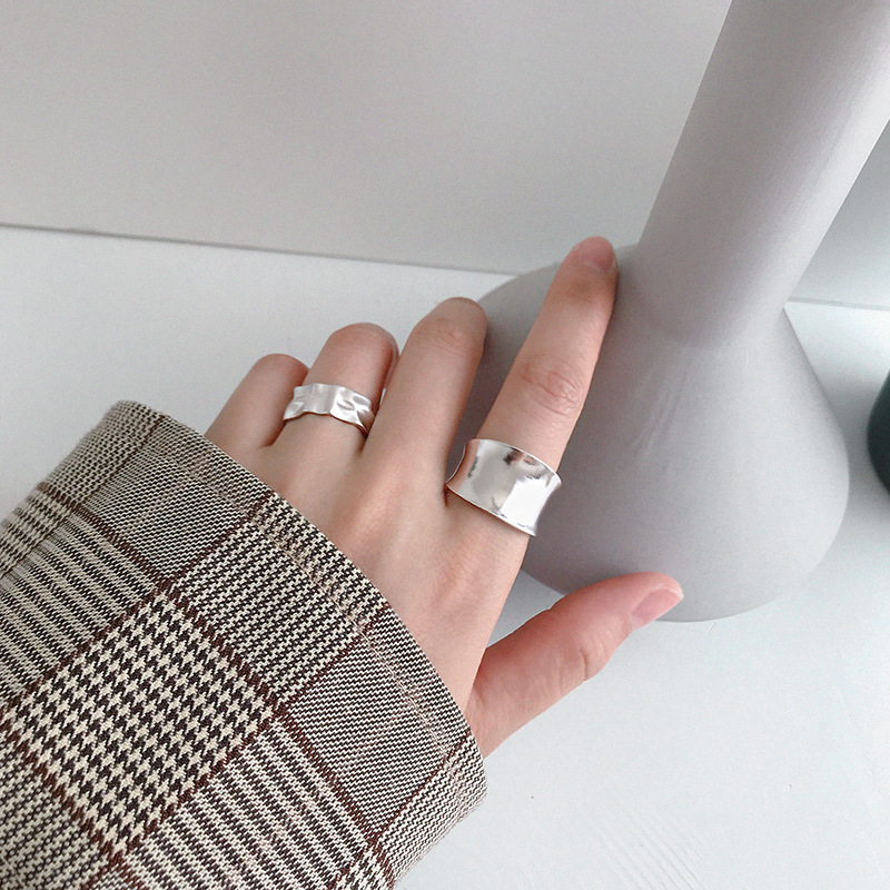 Sterling silver ring corss dressing